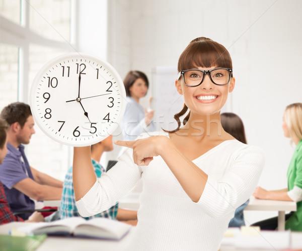 Estudante relógio educação atraente Foto stock © dolgachov
