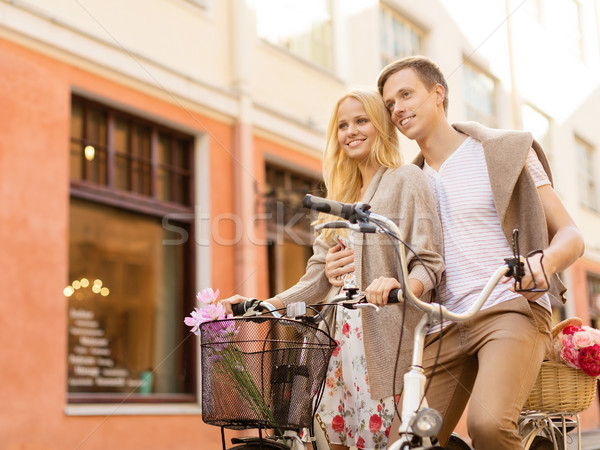 couple with bicycles in the city Stock photo © dolgachov