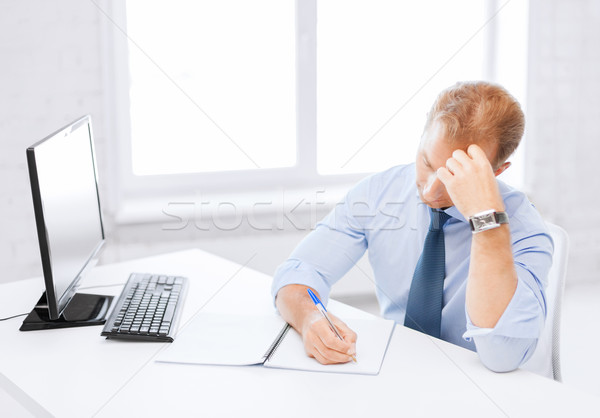businessman with notebook and computer Stock photo © dolgachov