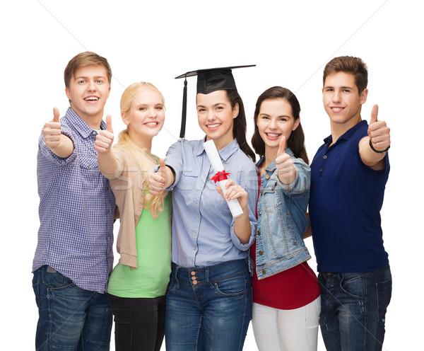 Csoport diákok diploma mutat remek oktatás Stock fotó © dolgachov