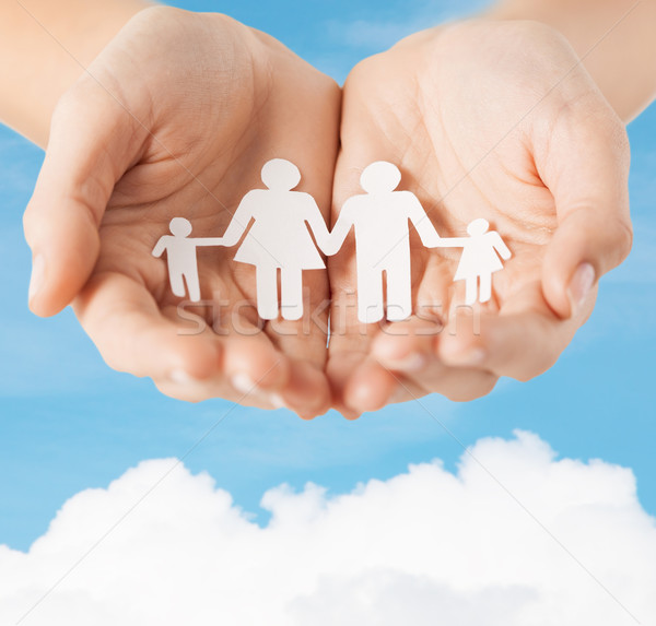 female hands with paper man family Stock photo © dolgachov