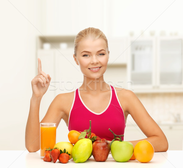 Mujer jugo frutas dedo hasta Foto stock © dolgachov
