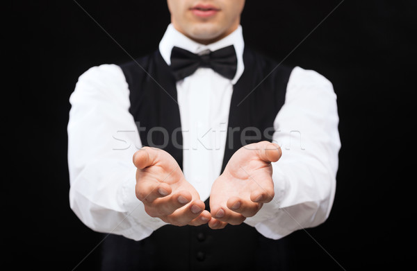 dealer holding something on palms of his hands Stock photo © dolgachov