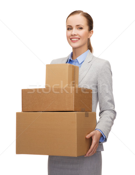 smiling businesswoman holding cardboard boxes Stock photo © dolgachov