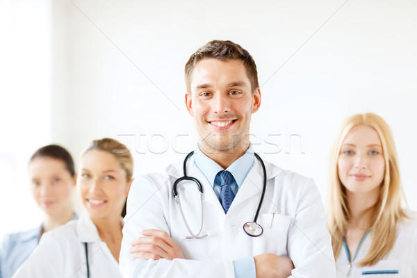smiling male doctor in front of medical group Stock photo © dolgachov