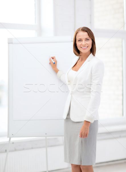 笑みを浮かべて 女性実業家 書く メモ帳 ビジネス 教育 ストックフォト © dolgachov