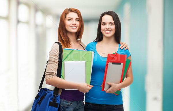 Kettő mosolyog diákok táska mappák tabletta Stock fotó © dolgachov