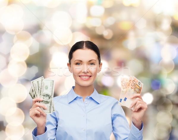 Zakenvrouw dollar cash geld business jonge Stockfoto © dolgachov