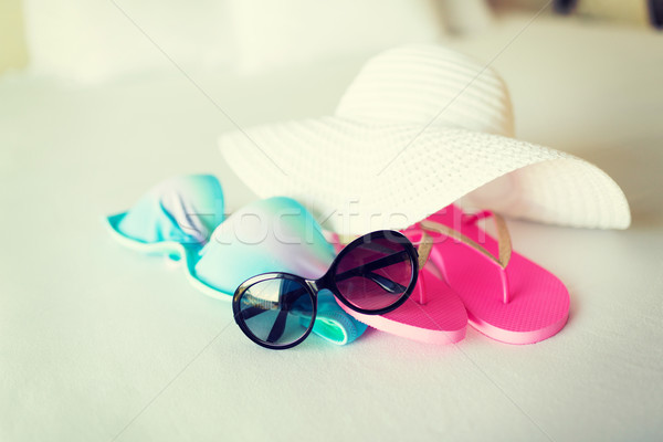 bikini top, hat, flip-flop and sunglasses Stock photo © dolgachov
