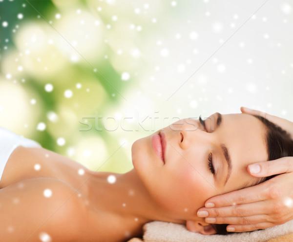 beautiful woman getting face or head massage Stock photo © dolgachov