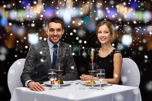 Mosolyog pár eszik főétel étterem karácsony Stock fotó © dolgachov
