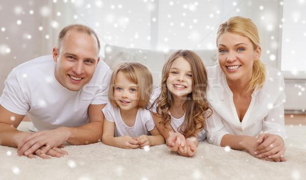 Mosolyog szülők kettő kislányok otthon család Stock fotó © dolgachov