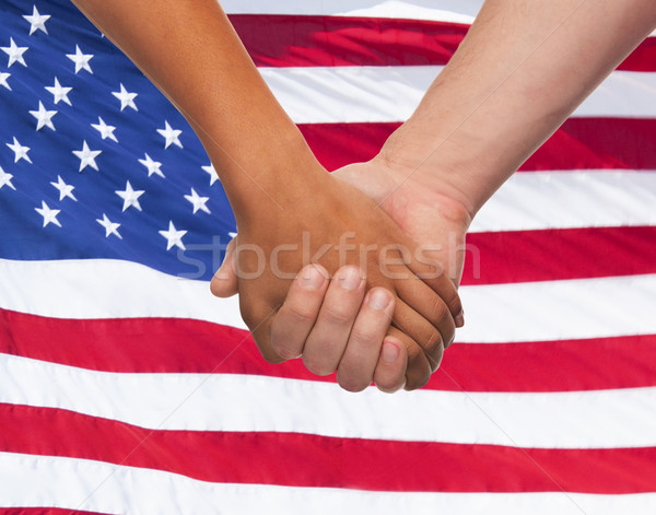 close up of hands holding over american flag Stock photo © dolgachov