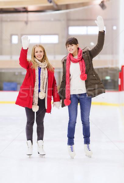 Boldog lányok barátok integet kezek korcsolyázás Stock fotó © dolgachov