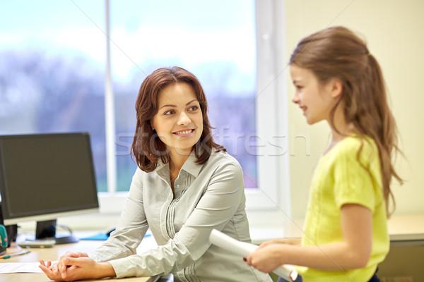 Schoolmeisje notebook leraar klas onderwijs Stockfoto © dolgachov