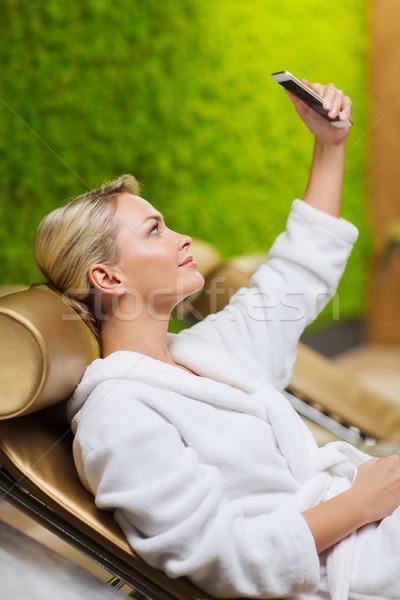 красивой смартфон Spa люди красоту Сток-фото © dolgachov