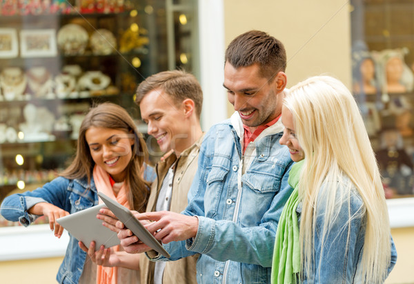group of smiling friends with tablet pc computers Stock photo © dolgachov