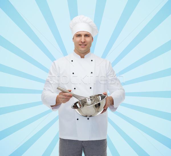Feliz masculina chef cocinar algo batidor Foto stock © dolgachov