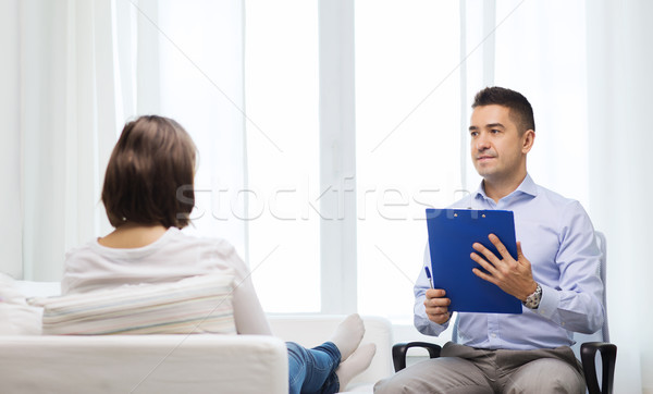 doctor and young woman meeting at home visit Stock photo © dolgachov
