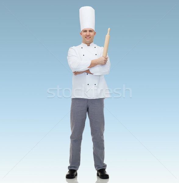 happy male chef cook holding rolling pin Stock photo © dolgachov