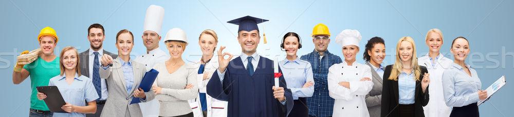 Boldog agglegény diploma szakemberek emberek hivatás Stock fotó © dolgachov