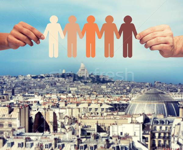 Eller kâğıt zincir insanlar topluluk Stok fotoğraf © dolgachov