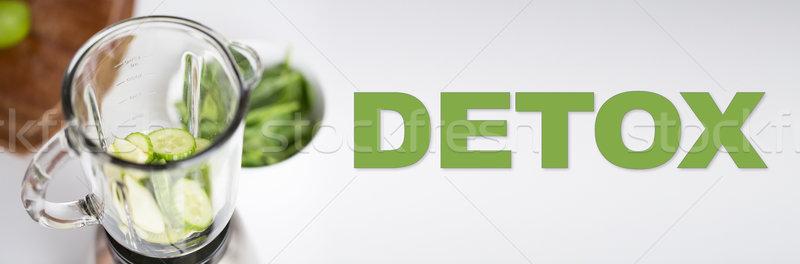 close up of blender jar and green vegetables Stock photo © dolgachov