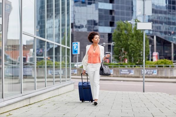 Fiatal afrikai nő utazás táska város Stock fotó © dolgachov