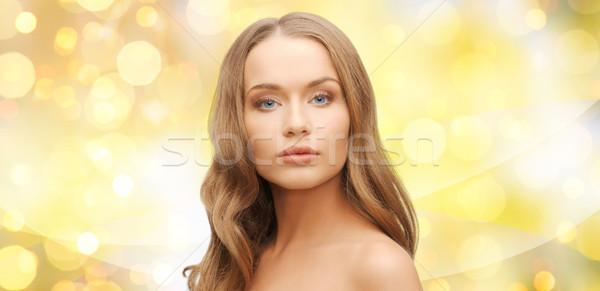Belo mulher jovem cara amarelo luzes beleza Foto stock © dolgachov