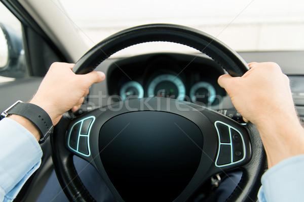 close up of man driving car with computer screen Stock photo © dolgachov
