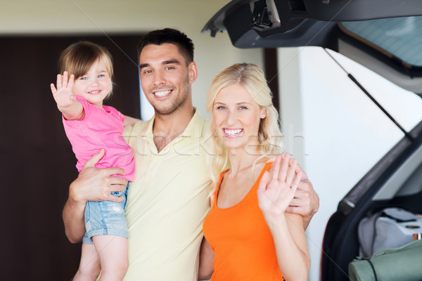 happy family with hatchback car at home parking Stock photo © dolgachov