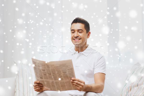 happy man reading newspaper at home Stock photo © dolgachov