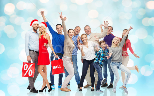 happy people with shopping bags having fun Stock photo © dolgachov