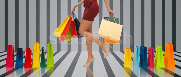 close up of woman on high heels with shopping bags Stock photo © dolgachov