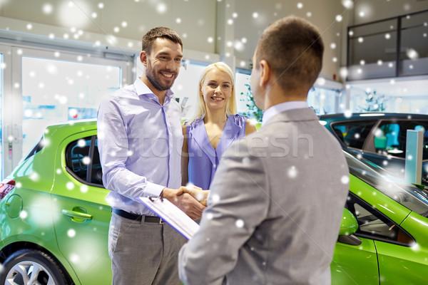 Mutlu çift araba satıcısı oto göstermek salon Stok fotoğraf © dolgachov