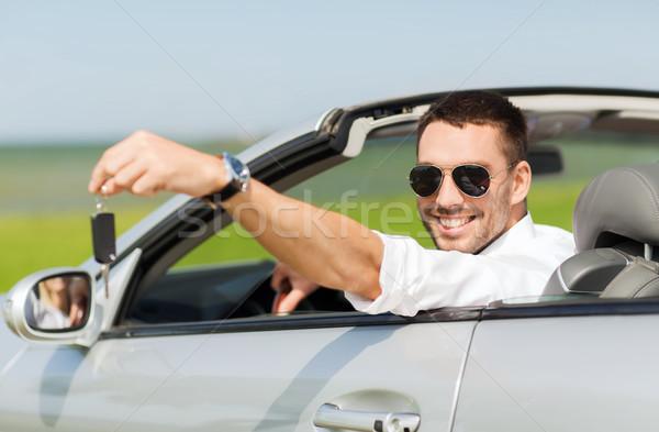 Felice uomo cabriolet auto Foto d'archivio © dolgachov