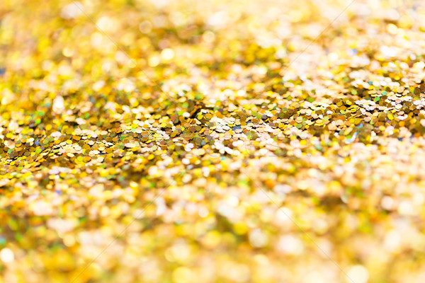 golden glitter or yellow sequins background Stock photo © dolgachov