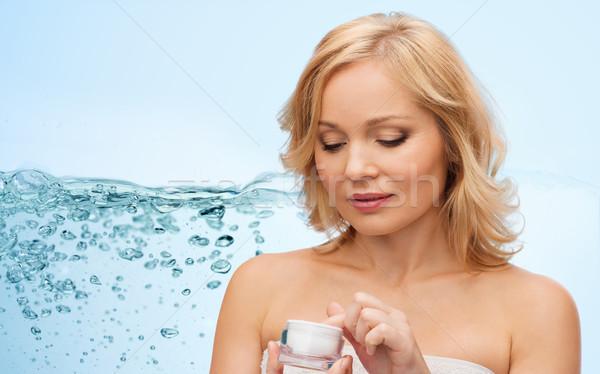 middle aged woman with cream jar Stock photo © dolgachov