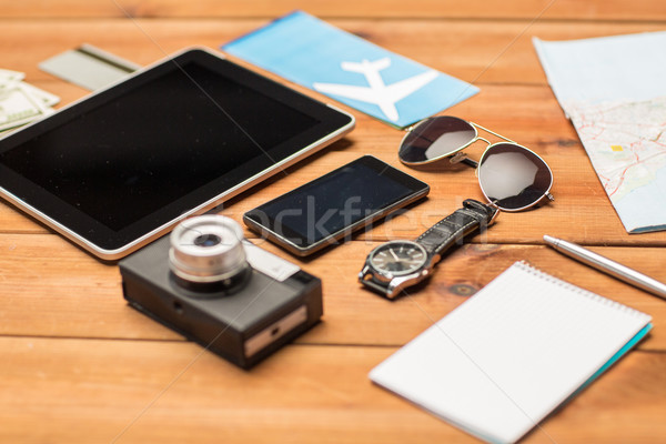 close up of smartphone and travel stuff Stock photo © dolgachov