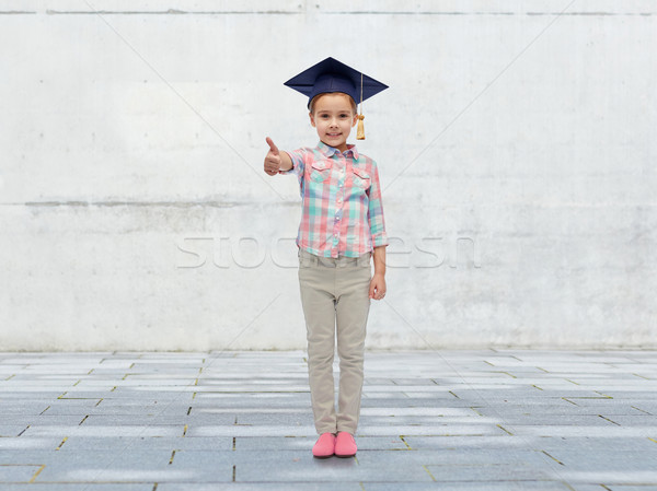 happy girl in bachelor hat showing thumbs up Stock photo © dolgachov