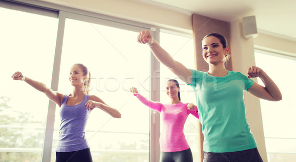 group of happy women working out in gym Stock photo © dolgachov