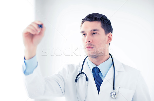 young doctor working with something imaginary Stock photo © dolgachov