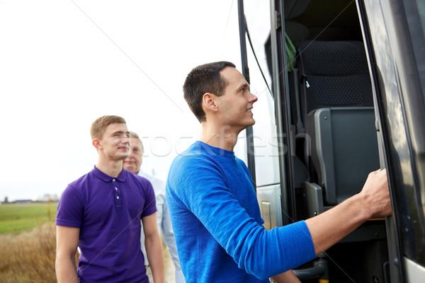 Grupo feliz masculina pasajeros embarque viaje Foto stock © dolgachov