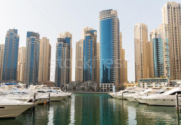 Dubai city seafront or harbor with boats Stock photo © dolgachov