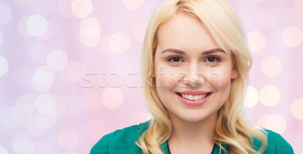 smiling young woman face Stock photo © dolgachov