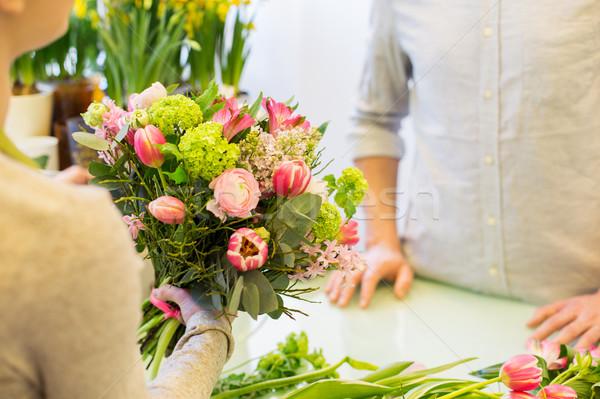 Fleuriste femme homme personnes Photo stock © dolgachov