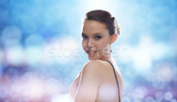 Gyönyörű fiatal ázsiai nő fülbevaló szépség Stock fotó © dolgachov
