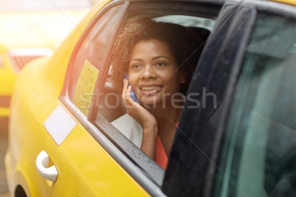 幸せ アフリカ 女性 呼び出し スマートフォン タクシー ストックフォト © dolgachov