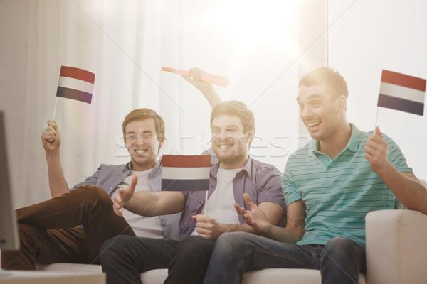 Сток-фото: счастливым · мужчины · друзей · флагами · дружбы · спортивных