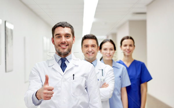 medics or doctors at hospital showing thumbs up Stock photo © dolgachov